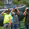 Special photo by Von Castor<br /> Welders from Advantage Controls use their helmets to safely view the eclipse Monday afternoon at Hyde Park.