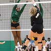 ABIGAIL WASHINGTON/Phoenix special photo<br /> Muskogee's Tiana Washington goes up for the block against Sand Springs' Raylynn Mong.