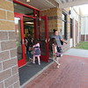 CATHY SPAULDING/Muskogee Phoenix<br /> Hilldale parent Amy Yelle holds Hilldale Elementary School's front door open for children on the first day of school. The Hilldale Education Foundation sold bricks laid in the front entrance.