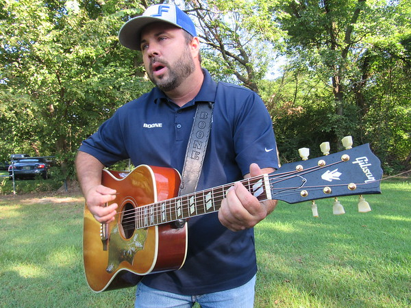 CATHY SPAULDING/Muskogee Phoenix<br /> Boone Mendenhall started playing guitar when he was in his 20s. He loved it so much, he started performing. Mendenhall will perform Thursday at the Oklahoma Music Hall of Fame.