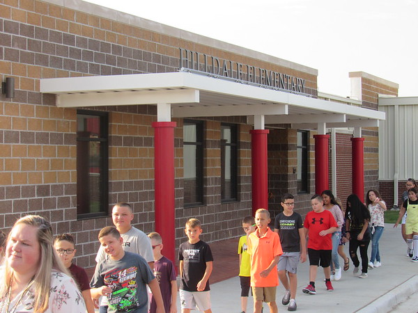 CATHY SPAULDING/Muskogee Phoenix<br /> Students pass Hilldale Elementary School's new entrance Wednesday on their first day of school. Hilldale Upper Elementary and Lower Elementary combined into one school this year.