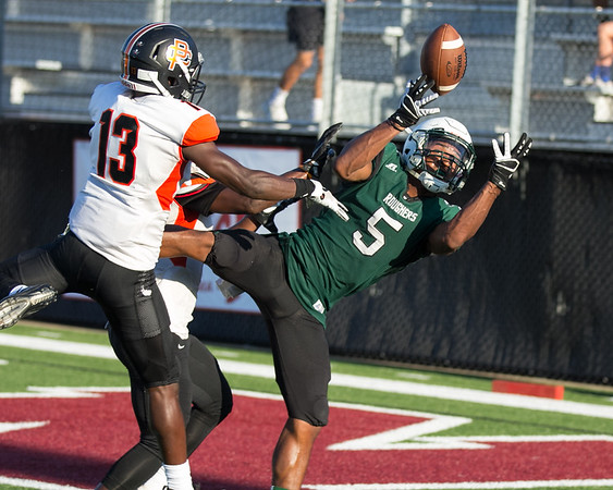 Phoenix special photo by Shane Keeter<br /> Muskogee's Devin Hillmon goes for the catch against Putnam City in last Friday's scrimmage.