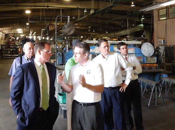 Staff photo by D.E. Smoot<br /> Lt. Gov. Todd Lamb, front left, gets a tour of the Acme Engineering and Manufacturing Corp. Muskogee plant on Wednesday from Brian Lanham, front right, executive vice president of manufacturing operations. Others pictured, from left, include Dick Morris, founder of Advantage Controls; House District 14 Rep. George Faught; and Jacob Ryan, who serves as executive aide for Lamb's campaign.