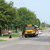 CATHY SPAULDING/Muskogee Phoenix<br /> A Muskogee school bus drops students off on Hancock Road.