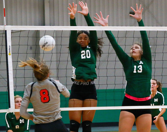 STEVEN VAN WORTH/Phoenix special photo<br /> Mya Williams and Laila Harshfield of the Muskogee Roughers defending against Tahlequah  at the MHS Tournament Friday morning.