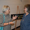 "Staff photo by Mark Hughes<br /> Gwen Coburn talks to Kim Lynch at the conclusion of the Action in Muskogee public hearing Thursday evening at the Dr. Martin Luther King Jr. Community Center. ""I was aware of many of the projects but I'm excited for the future of them,"" Lynch said."