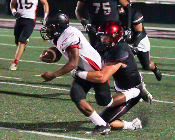 Phoenix special photo by Shane Keeter<br /> Hilldale's Mikey Winston is wrapped up by Wagoner's Patrick Curley.