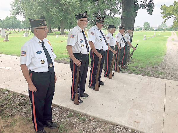 CHESLEY OXENDINE/Muskogee Phoenix<br /> The James S. Smith American Legion Post 15 color guard attends a funeral at Greenhill Cemetery to honor a veteran. Paul McKinstry hopes to host an event to clean up veterans' tombstones at Greenhill.