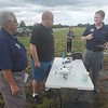 CHESLEY OXENDINE/Muskogee Phoenix<br /> Muskogee Nighthawk Squadron Civil Air Patrol members Jason Unwin (left) and Clinton Morgan (right) give Paul Watts a lesson on drone usage during a demonstration event Saturday morning.