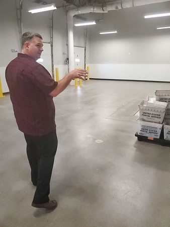 CHESLEY OXENDINE/Muskogee Phoenix<br /> Muskogee Postmaster Chris Baker gives a tour of the new post office location at 501 N. Main St. inside the east end of Arrowhead Mall.