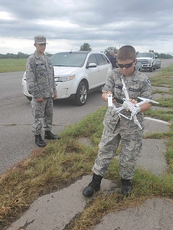 CHESLEY OXENDINE/Muskogee Phoenix<br /> Enoch Blasi looks on as fellow Civil Air Patrol Cadet Caleb Brown inspects an HS700 drone during Saturday's demonstration event for the Muskogee Nighthawks Squadron.