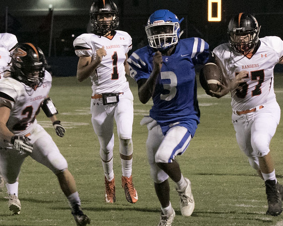 Phoenix special photo by Abigail Washington<br /> Checotah's Malik Carr, center, runs past Roland's Cole Davis, left, and Devin Kelsey for a 59-yard touchdown during the Wildcats' win on Friday.