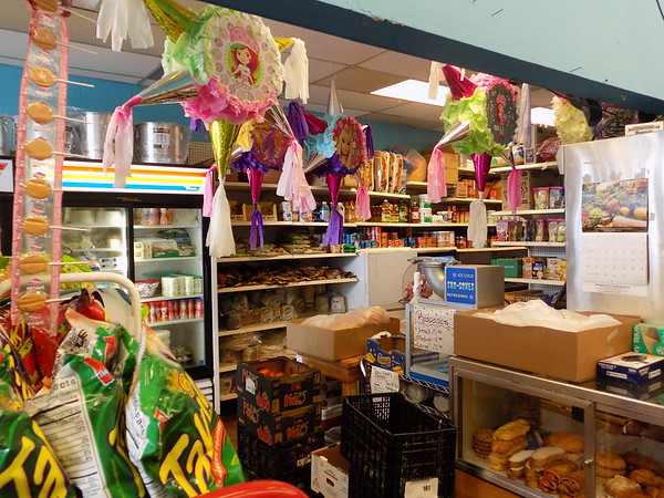 Staff photo by Mike Elswick<br /> The aisles at Abarrotos Esmeralda, 1310 East Side Blvd., in Lakeland Shopping Center, feature a variety of items, from pinatas to Hispanic grocery items.