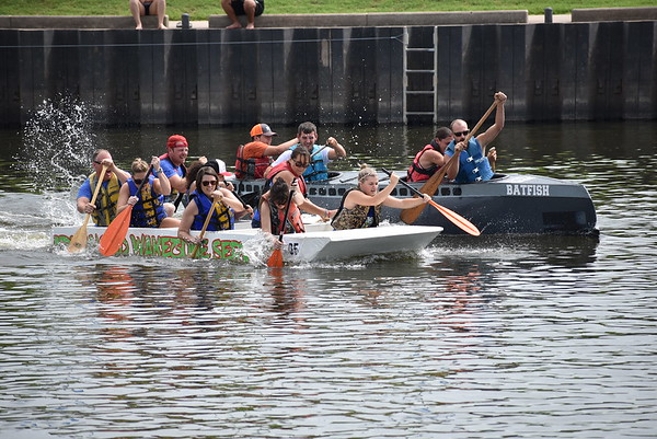 Staff photo by Mark Hughes<br /> Crew members of Advanced Wakezone Services are neck-and-neck with the Batfish in the initial start of their heat at Saturday's River Rumba  Regatta sponsored by the Exchange Club. Wakezone won the heat but didn't make the finals.