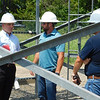 D.E. SMOOT/Muskogee Phoenix<br /> U.S. Rep. Markwayne Mullin, R-Westville, center, and Michael Queenan, left, discuss workforce issues on Monday with representatives from the wireless communications tower industry during a tour of a site in Muskogee. Queenan is manager of U.S. government affairs for American Tower Corp.
