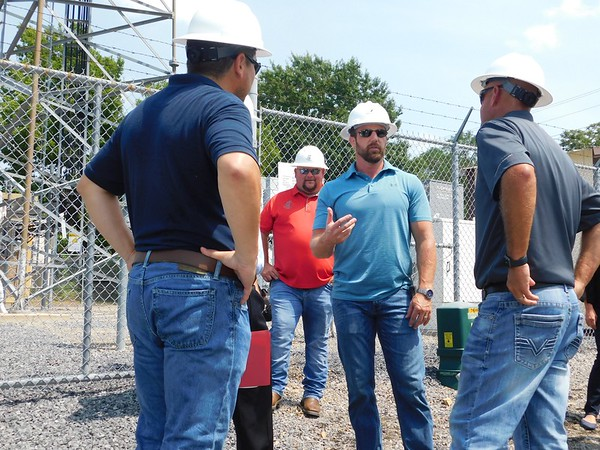 D.E. SMOOT/Muskogee Phoenix<br /> U.S. Rep. Markwayne Mullin, R-Westville, center, discusses workforce issues on Monday with representatives from the wireless communications tower industry during a tour of a site in Muskogee.