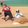 JOHN HASLER/Phoenix special photo<br /> Muskogee's D'Asia Brown beats a pick-off throw at first Base during Monday's game against Claremore.