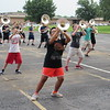 CATHY SPAULDING/Muskogee Phoenix<br /> Fort Gibson Royal Regiment brass players lean into a step during a morning practice.