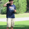CATHY SPAULDING/Muskogee Phoenix<br /> Beau Slover manages to catch a cell phone call while waiting to catch fish. The two, along with friend Richard Williams, tried different spots around the Spaulding Park pond to go fishing.