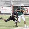 SHANE KEETER/Phoenix Special Photo<br /> Muskogee's new quarterback, Ty Williams, looks for yardage in the first week of scrimmage action. He'll make his first start Friday against McAlester at Indian Bowl.