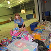 Staff photo by Cathy Spaulding<br /> Bailey Tull sorts through backpacks and school supplies to be given away at 5 p.m. Sunday at First United Methodist Church. It is one of several giveaways set for the next few weeks.
