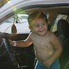 Staff photo by Harrison Grimwood<br /> Austin Moses, 2, gets ready to take a Muskogee Police Department cruiser for a spin at Robison Park during Okies Neighborhood Night Out.