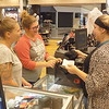Staff photo by Mike Elswick<br /> Shoppers Amber Richardson, left, and Brooklyne Lefler visited with The Buckle sales associate Cherokee Capps while checking out on Tuesday. The store is one of many in the state where staff is expecting more customers than usual during the state's sales tax-free weekend beginning Friday.