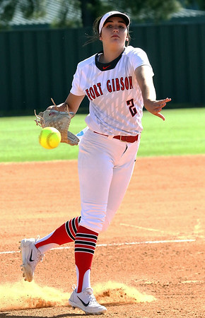 Phoenix special photo by John Hasler<br /> Fort Gibson's Courtney Hill no-hit Roland on Tuesday at home. The Lady Tigers won 18-0.