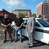 KENTON BROOKS/Muskogee Phoenix<br /> Muskogee County Sheriff Rob Frazier, middle, donates a car to the Connors State College police department on Wednesday. Frazier made the presentation to Connors Police Chief James Mendenhall, left, and Connors President Dr. Ronald Ramming.