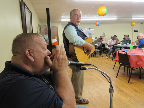 "CATHY SPAULDING/Muskogee Phoenix<br /> Keefeton Freewill Baptist Church Pastor Danny Barks plays harmonica while Jack Murr plays guitar and leads ministers in ""Amazing Grace"" during the Ministerial Alliance kickoff luncheon, held Wednesday at Gospel Rescue Mission."