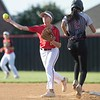 VON CASTOR/Phoenix special photo<br /> Hilldale shortstop Celeste Wood turns a double play to end the game as Wagoner baserunner approaches second base Thursday evening at Hilldale Field.