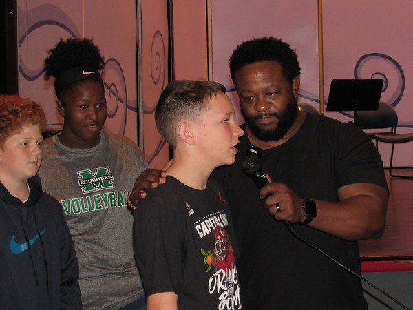 CATHY SPAULDING/Muskogee Phoenix<br /> Sadler Arts Academy seventh-graders, from left, Miles Nelson, Kye Carter and Caleb Smith attempt to answer a question posed by motivational speaker Lonnie Barker during a Friday assembly honoring Sadler teachers.
