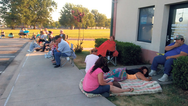 Staff photo by Wendy Burton<br /> More than 40 people wait for the Department of Public Safety in Muskogee to open on Thursday morning — including one family who was making their sixth trip to try to get their son's drivers license test, and who began the day lined up at 3 a.m.