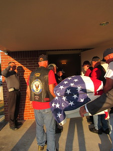 CATHY SPAULDING/Muskogee Phoenix Members of the Patriot Guard Riders carry the coffin of Seaman First Class Eugene Wicker into Clifford D. Garrett Family Funeral Home on Friday night.