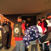 CATHY SPAULDING/Muskogee Phoenix<br /> Members of the Patriot Guard Riders carry the coffin of Seaman First Class Eugene Wicker into Clifford D. Garrett Family Funeral Home on Friday night.