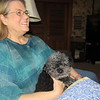 CATHY SPAULDING/Muskogee Phoenix<br /> Pam Lipscomb rests with her miniature poodle Mocha Joe. She said the poodle was a rescue.