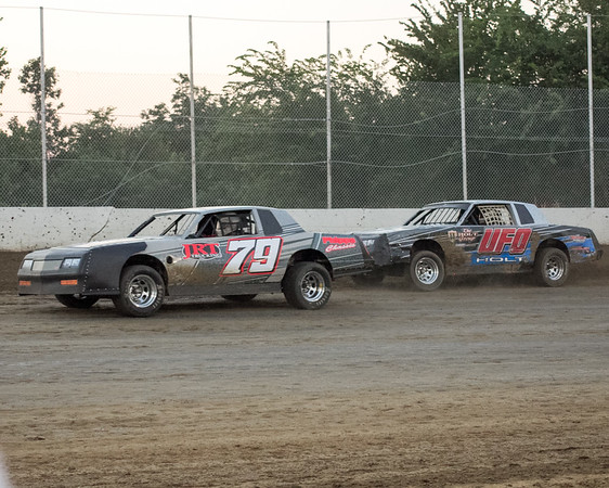 Phoenix special photo by Shane Keeter<br /> Allen Owen gets by Ted Holt during Friday's heat race in Pure Stock at Thunderbird Speedway.