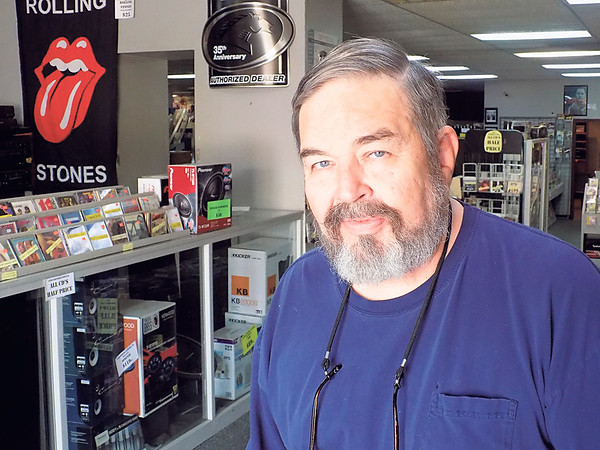 Staff photo by Mike Elswick<br /> Longtime Soundworld owner Ernie Lindsey stands in the entryway of his stereo and music business. He has announced plans to close after 40 years.