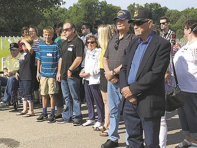 CHESLEY OXENDINE/Muskogee Phoenix The Wicker family enters Saturday's service for Seaman First Class Eugene Wicker. Wicker's nephew Eugene Woodrow Wicker (front-right) provided the DNA used to identify the sailor's remains.