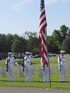CATHY SPAULDING/Muskogee Phoenix Sailors stand at attention, waiting to fire a three-volley salute Saturday at the funeral for World War II Seaman First Class Eugene Wicker.
