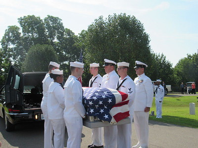 CATHY SPAULDING/Muskogee Phoenix Members of the U.S. Navy remove Seaman First Class Eugene Wicker's casket from a hearse before his funeral Saturday at Fort Gibson National Cemetery.