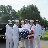 CATHY SPAULDING/Muskogee Phoenix<br /> Members of the U.S. Navy remove Seaman First Class Eugene Wicker's casket from a hearse before his funeral Saturday at Fort Gibson National Cemetery.