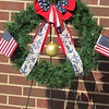 CATHY SPAULDING/Muskogee Phoenix<br /> A wreath was presented at the funeral Saturday for Seaman First Class Eugene Wicker.