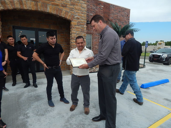 KENTON BROOKS/Muskogee Phoenix Warner Chamber of Commerce president Aaron Ellis, right, presents a certificate of appreciation to Abel Gonzales, the owner of El Jaracho Mexican restaurant after the ribbon-cutting this past week. Gonzales owns restaurants in Checotah, Greenville, Ark. and Tulsa and said he will be opening another one soon in Eufaula.
