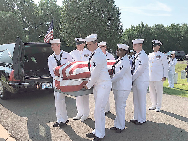 CHESLEY OXENDINE/Muskogee Phoenix Sailors from the Tulsa Navy Operations Support Center carry Seaman First Class Eugene Wicker's coffin from the hearse during Saturday's ceremony.