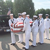 CHESLEY OXENDINE/Muskogee Phoenix<br /> Sailors from the Tulsa Navy Operations Support Center carry Seaman First Class Eugene Wicker's coffin from the hearse during Saturday's ceremony.