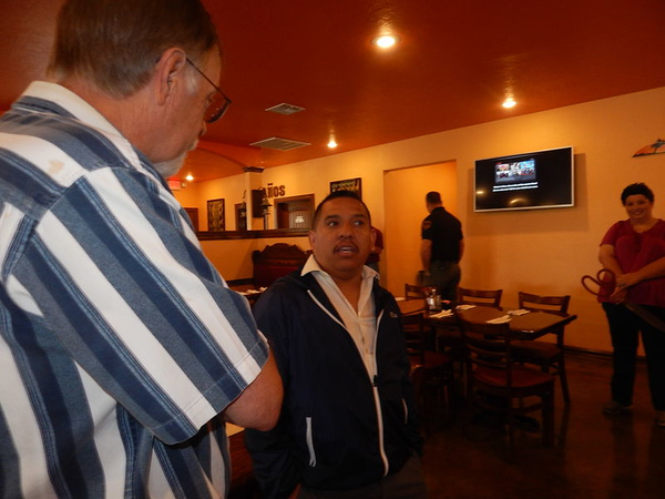 KENTON BROOKS/Muskogee Phoenix<br /> El Jaracho owner Abel Gonzales, right, talks with Warner Mayor Roger Thomason this week after the ribbon-cutting for the new Mexican restaurant at 710 S. Oklahoma 2. Gonzales also has restaurants in Tulsa, Greenville, Ark., and Checotah. He said he will be opening another location soon in Eufaula.,