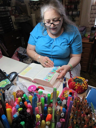 Staff photo by Cathy Spaulding<br /> Patricia Cobb keeps multiple colors of pens and pencils handy to express her thoughts through Bible journaling.