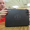 CATHY SPAULDING/Muskogee Phoenix<br /> Fort Gibson Technology Director Jason Wicks shows the Fort Gibson school logo etched on 900 new Chromebook laptop computers. The laptops will be leased to middle school and high school students when the school year starts.