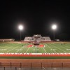 VON CASTOR/Phoenix special photo<br /> Hilldale's football team huddles on the mid-field logo of the school's new artificial playing surface prior to practicing Monday at midnight. It was the first time the team has used the turf since its installation.